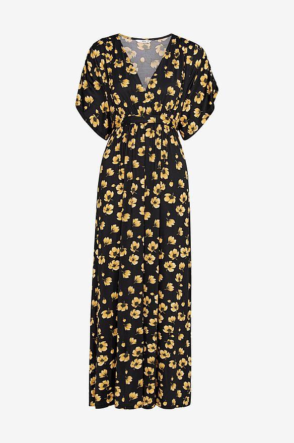 svart klänning med gula blommor